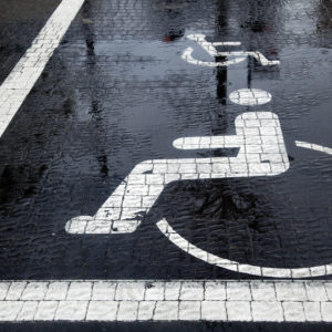 Accessible parking space in the rain.