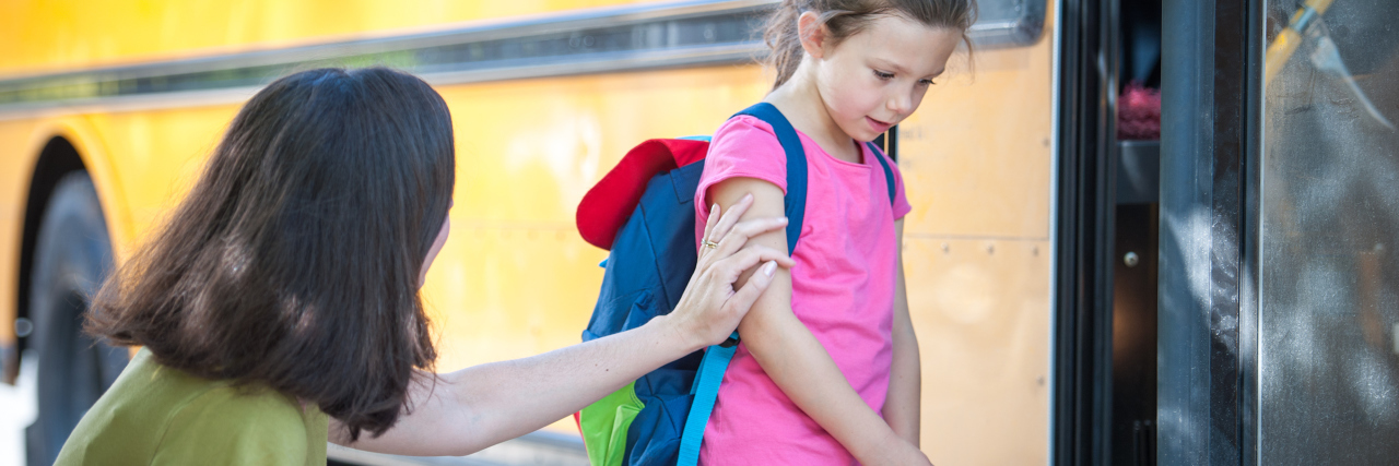 mother leaving child at school bus worried about leaving her