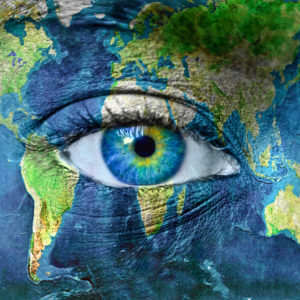 A woman's face painted with the globe, focusing close to her eye.