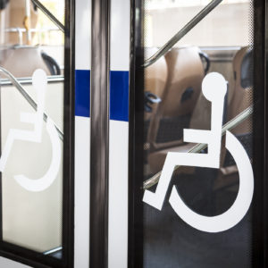 disability signs on the door of a bus