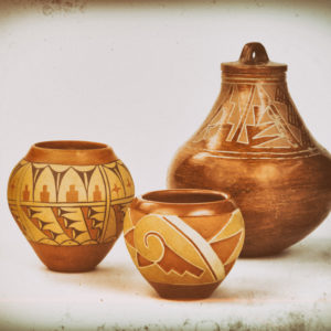 Three Native American Pueblo pottery vases.