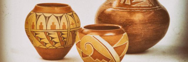 Three Native American Pueblo pottery vases.