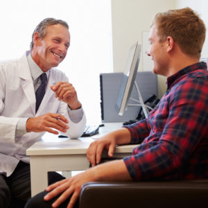 A male patient meeting with his doctor.