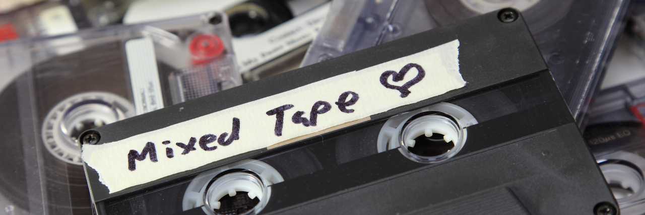 A mix tape on top of several other tapes.