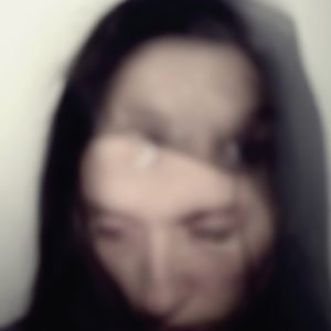 Out of focus, multiple exposure portrait of a young Caucasian woman.