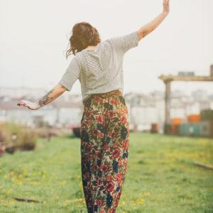 faded photo of woman walking on train tracks