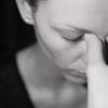 Woman suffering from headache.