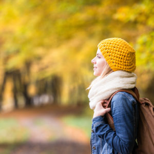 woman walking in the park during autumn