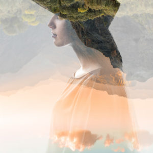double exposure photo of a woman wearing a hat and mountains and sky