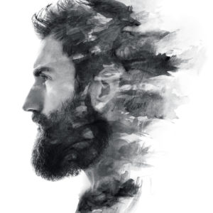 Portrait of a bearded man fading in black and white