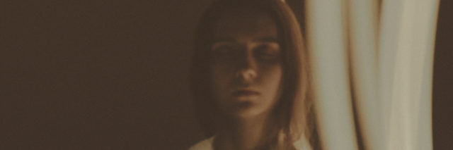 A photo of a woman with a light affect.