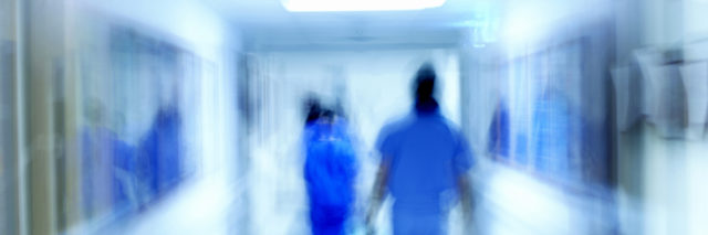 Hospital personnel in a hallway