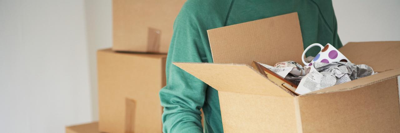 Man Carrying Cardboard Box