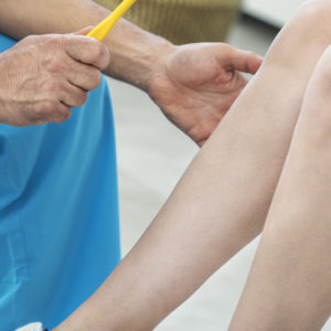 Doctor examining a knee.
