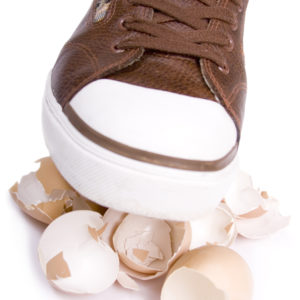 Shoe walking on eggshells.