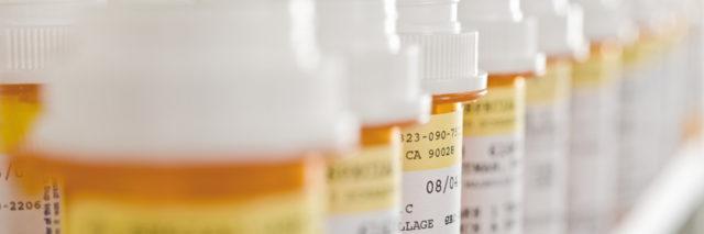 line up of prescription bottles