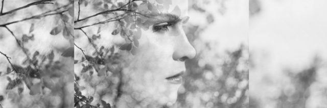 black and white double exposure photo of a woman and tree branches