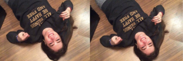 woman lying on the floor laughing