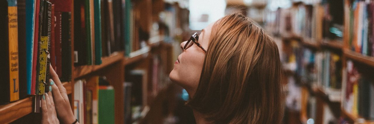 girl in library at college