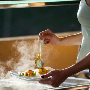 woman serving herself food
