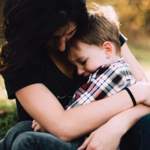 mom holds son in her arms