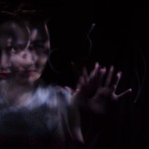 double exposure of woman reaching out to camera