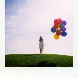 polaroid girl with balloons