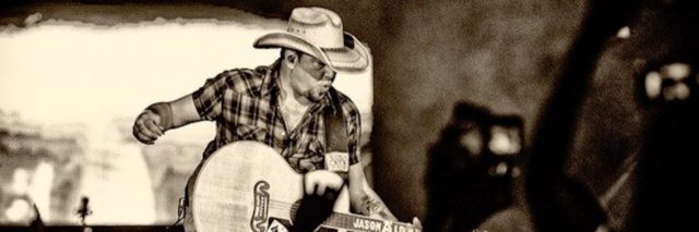 jason aldean performing at a concert