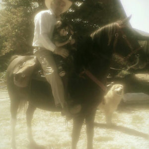 Julia Trecanao's father with her daughter, riding a horse.