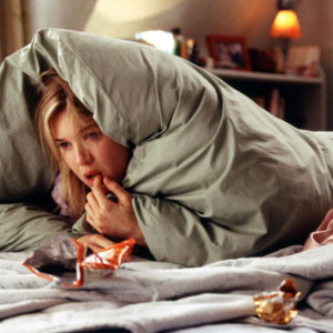 bridget jones curled up in bed eating snacks