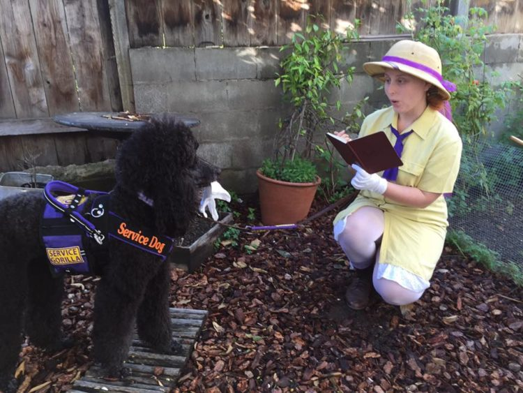 woman and her service dog dressed up as Jane (from Tarzan) and a gorilla