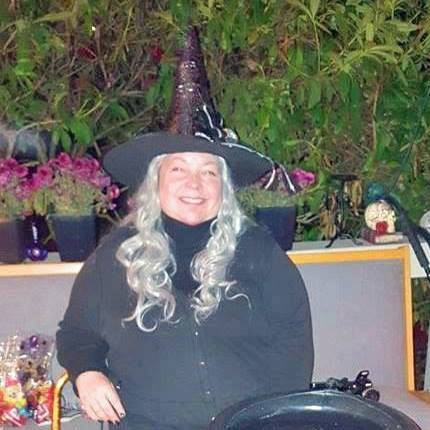woman dressed as a witch with a cauldron