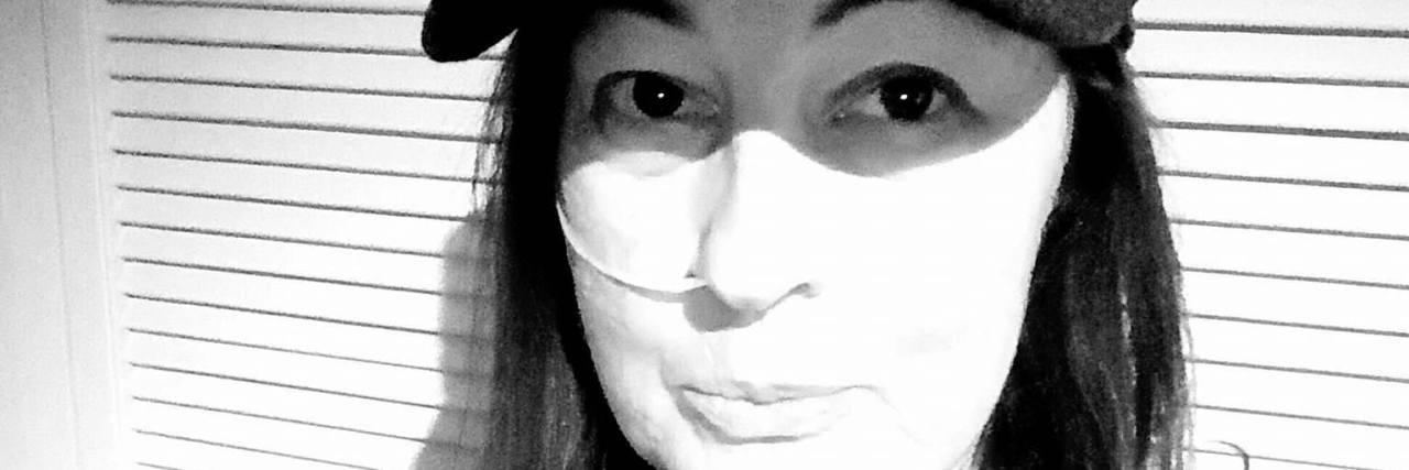 black and white photo of a woman with a feeding tube in her nose