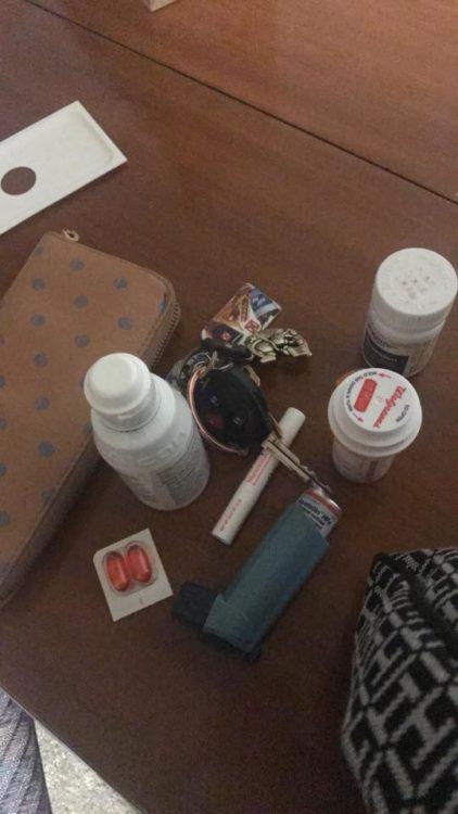 pill bottles, keys and wallet