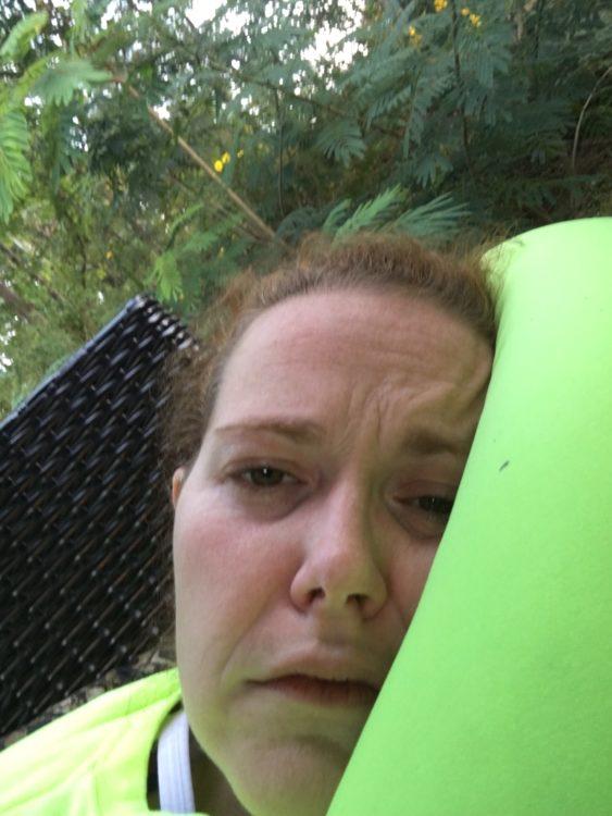 woman lying outside looking sick