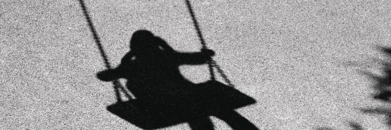 shadow of child swinging