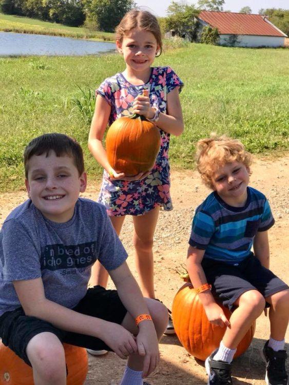 Three siblings at pumpkin patch