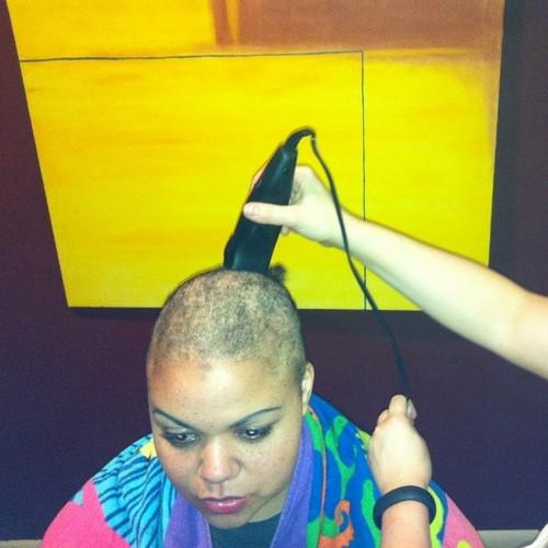 Charity Bryan getting head shaved