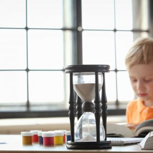 Boy with timer doing homework
