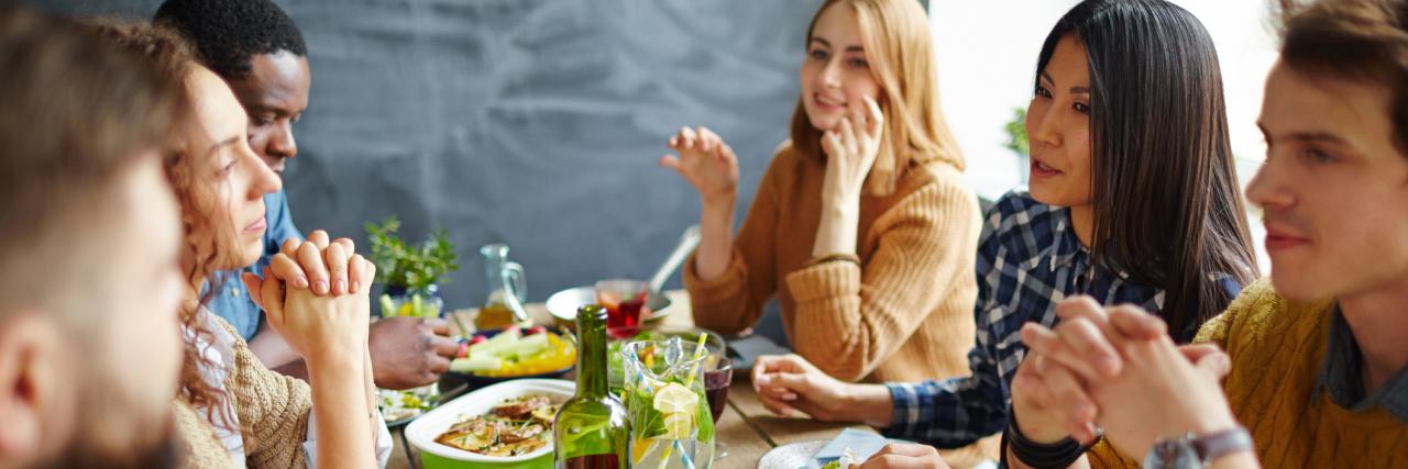 friends eating thanksgiving dinner