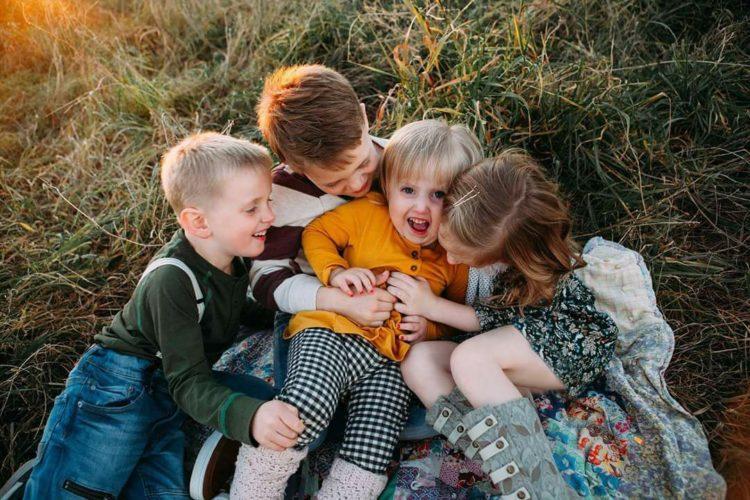 Four siblings hugging