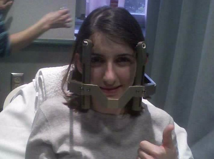 michaela oconnor getting treatment wearing a device on her head