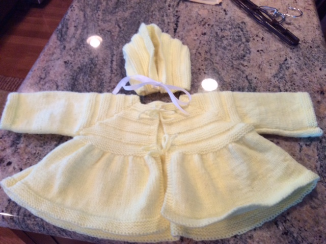 A yellow knit sweater that was donated to Ann's Place in Danbury Connecticut.