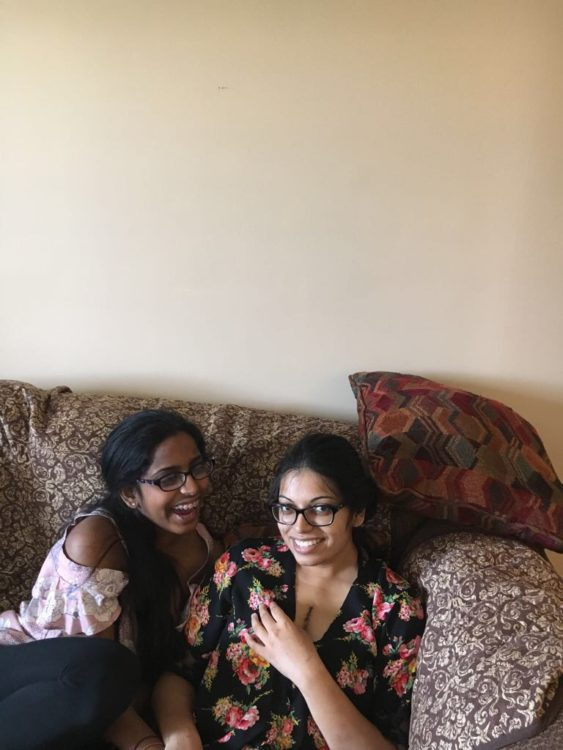 The writer and her friend sitting on the couch, the day she returned home from the hospital.