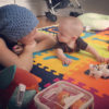 Jessica Sliwerski playing with Penelope on playmat