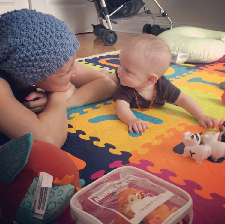 Jessica Sliwerski playing with Penelope on playmat