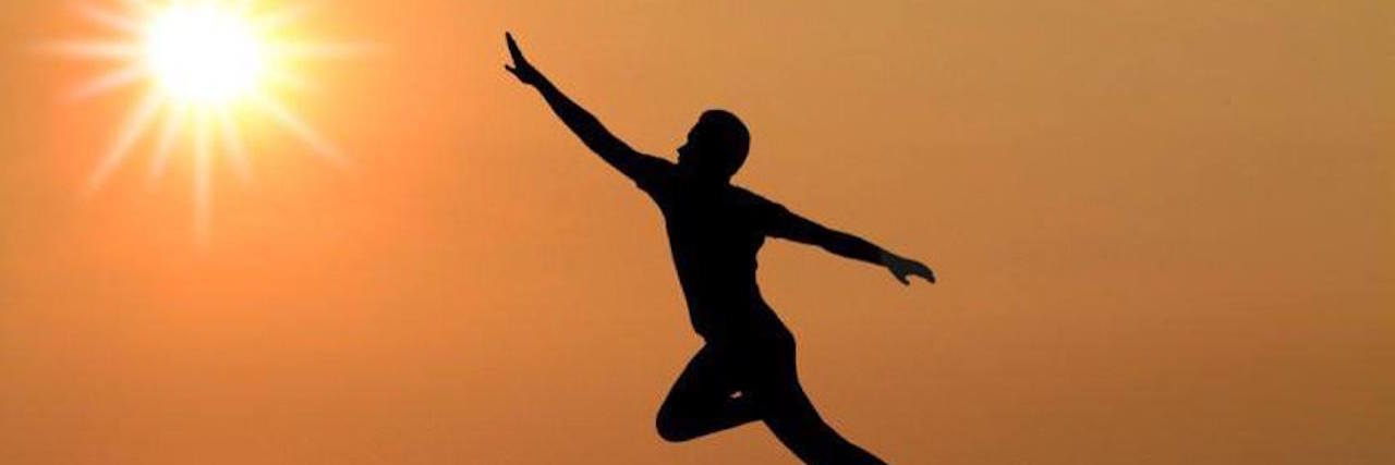 man jumping between cliffs in a 'leap of faith'