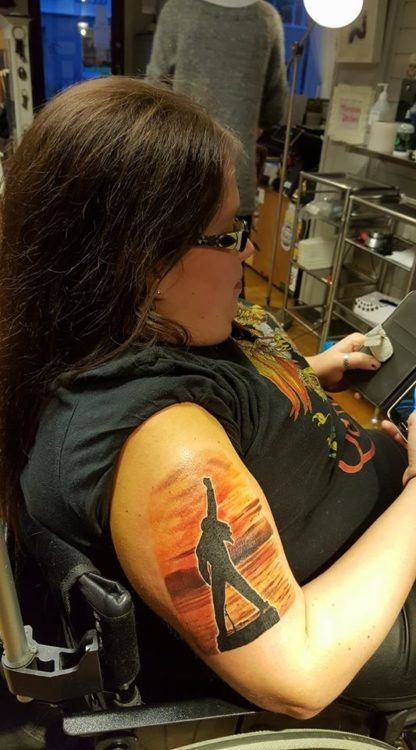 Girl showing arm tattoo
