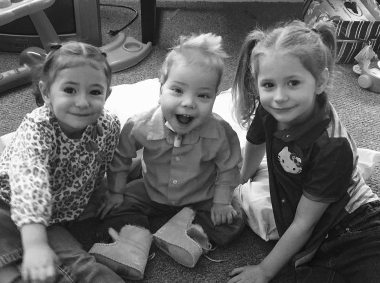 Black and white picture of three siblings