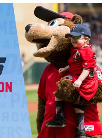 Little boy carried by Twins mascot